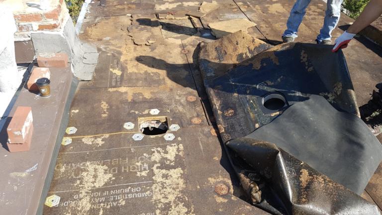Flat roof repair at ice damming area