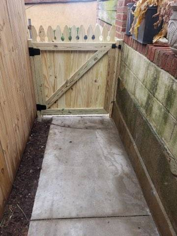 New concrete walkway with stone retaining walls