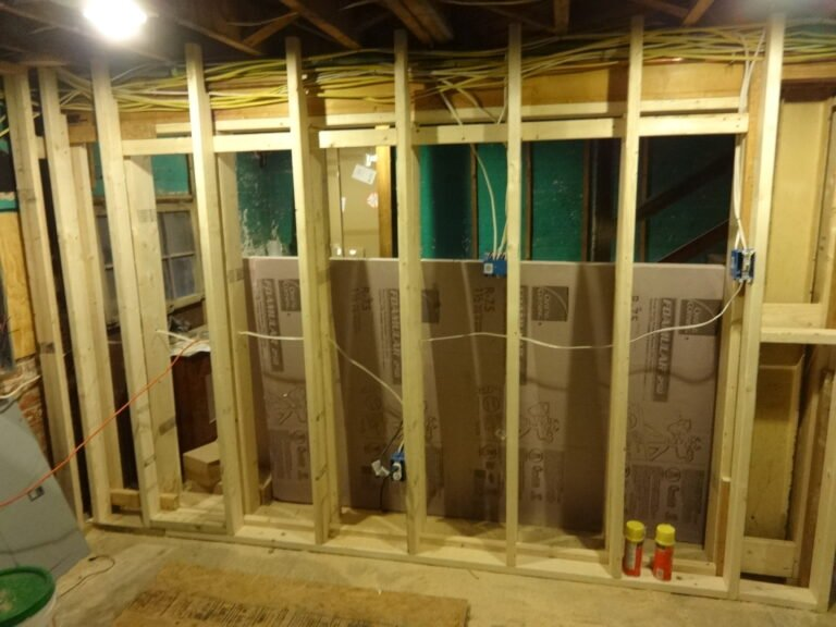 New wall framing in finished basement